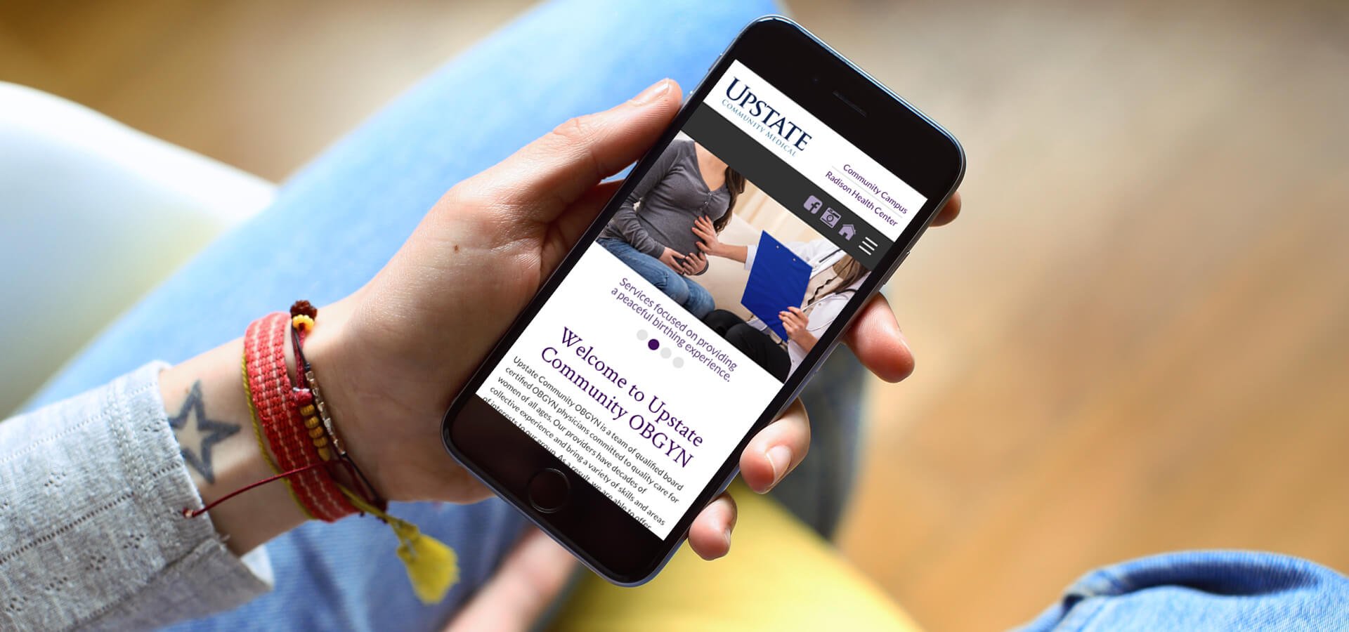 Upstate Community OBGYN Website on Mobile Phone