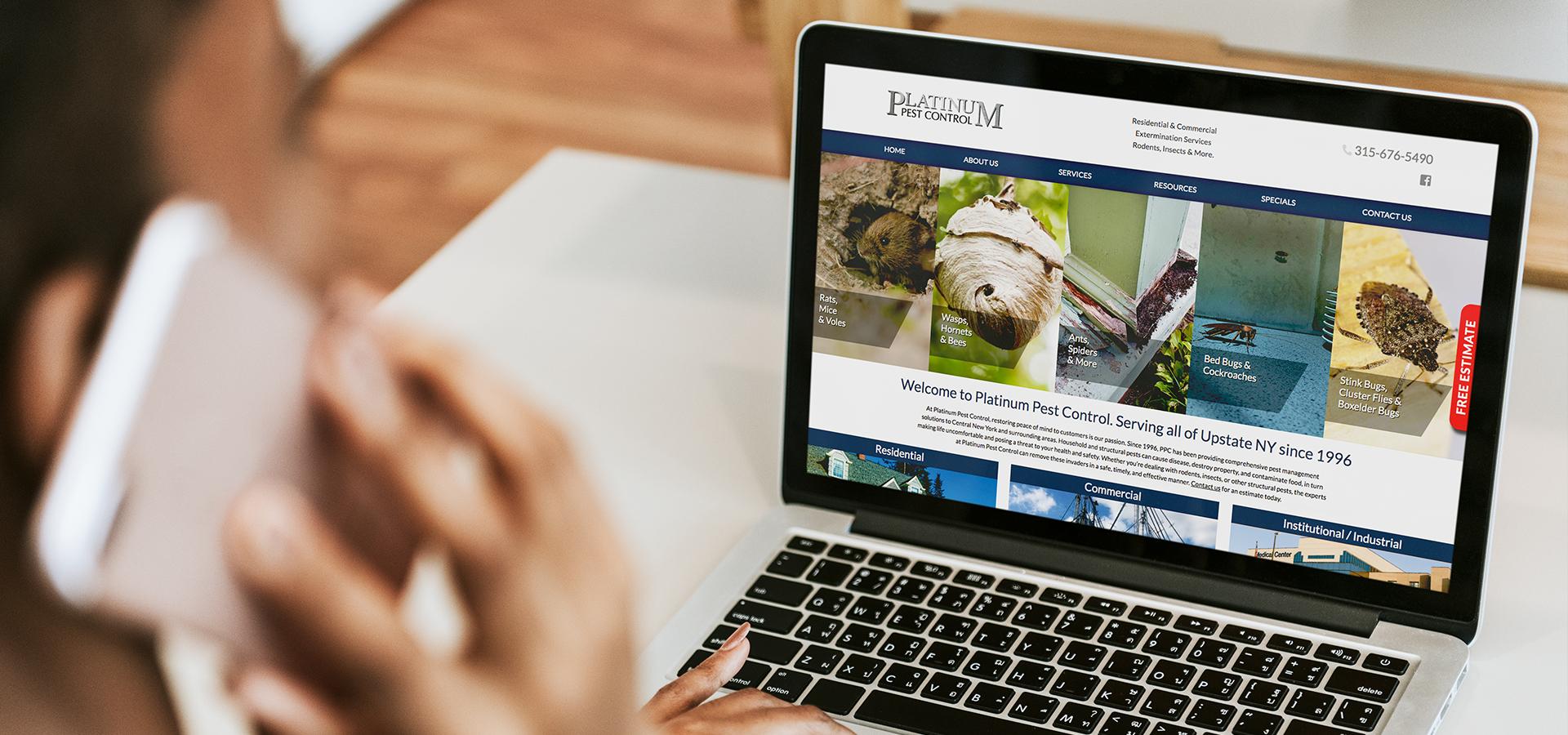 Platinum Pest Control website on laptop